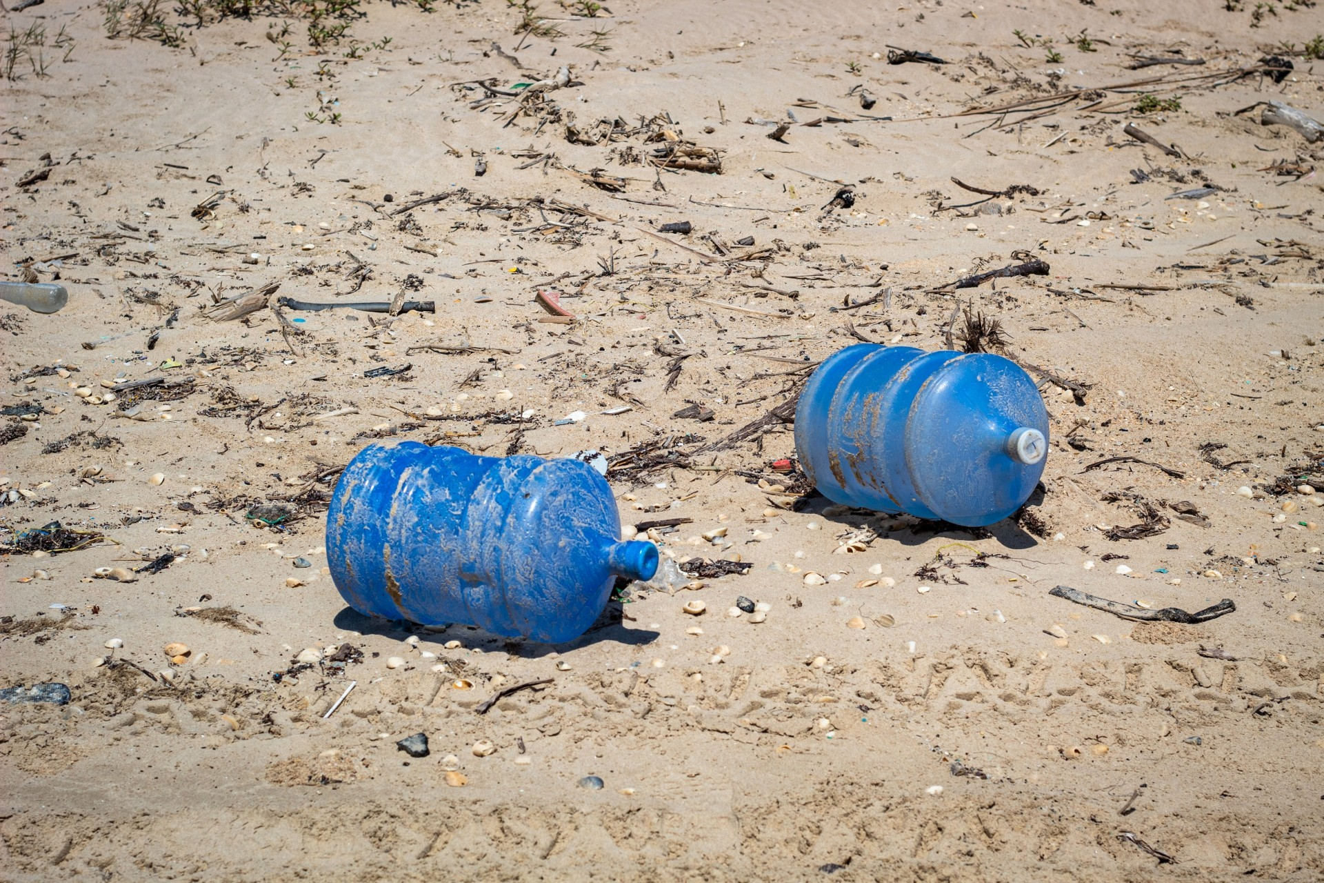 Large water carriers thrown into the sea and washed up on the beach