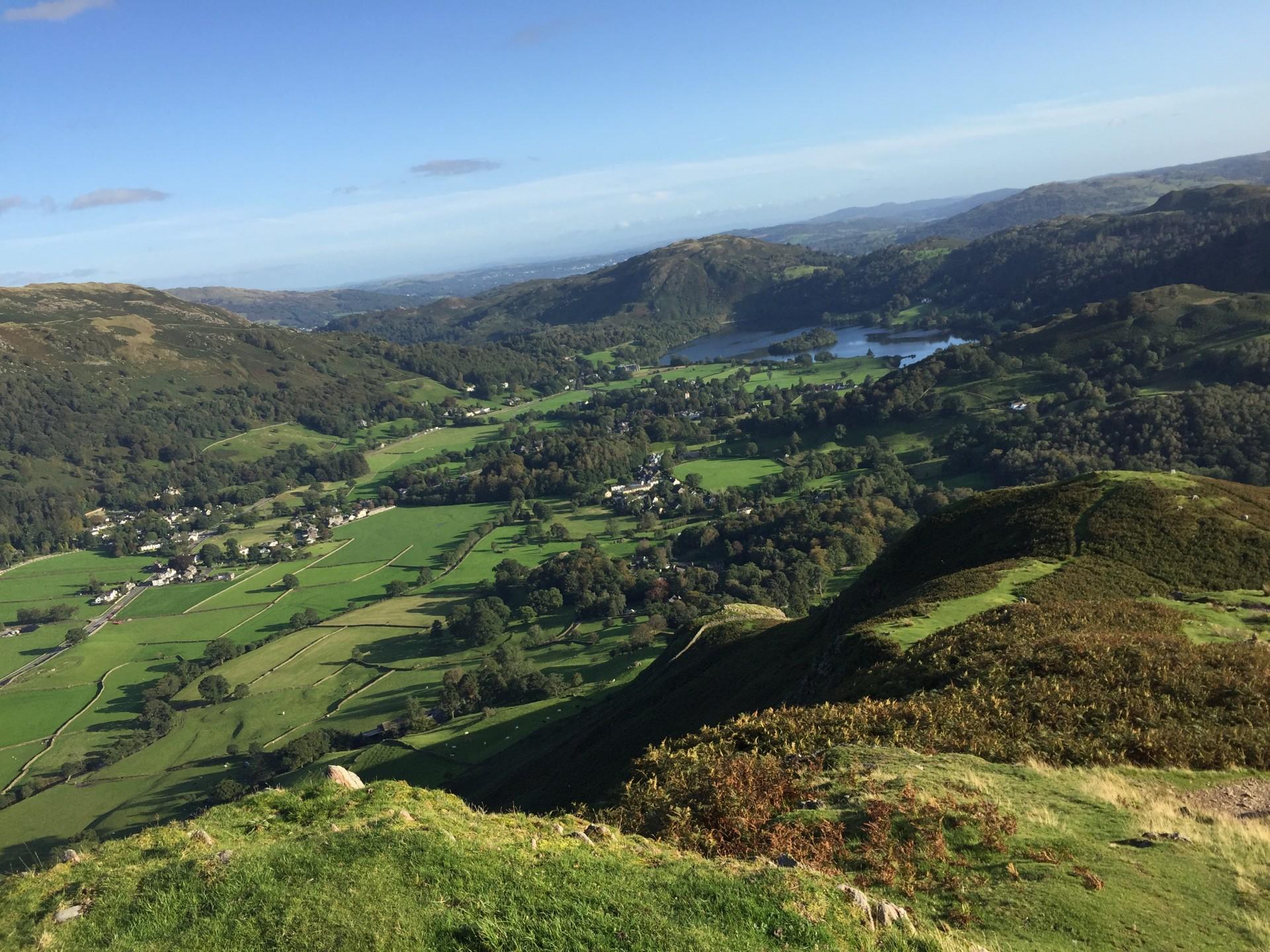 Guided hiking and wild camping trips in the Lake District approaching Grassmere on a sunny day