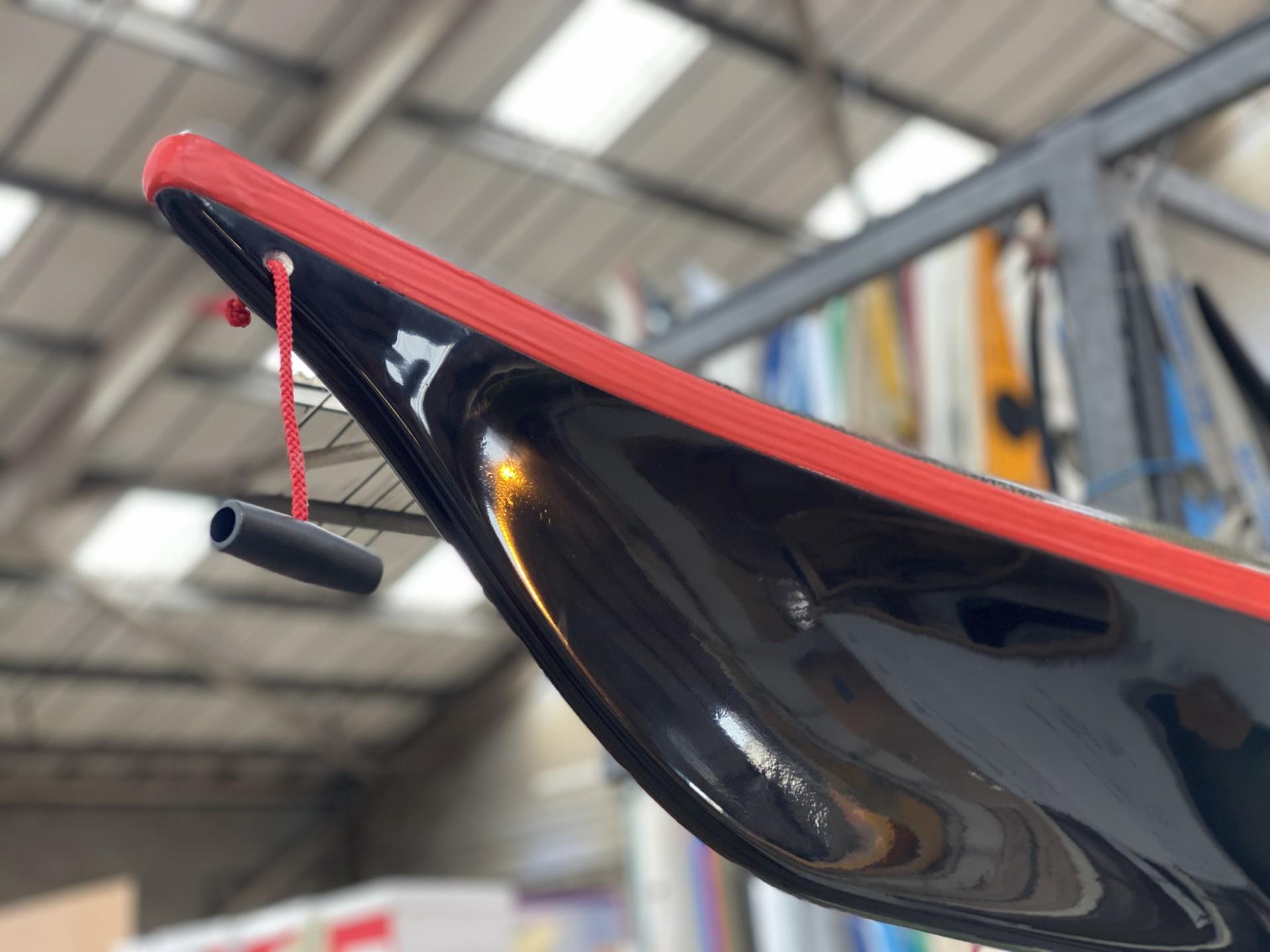 NDK Explorer sea kayak black composite with red trim