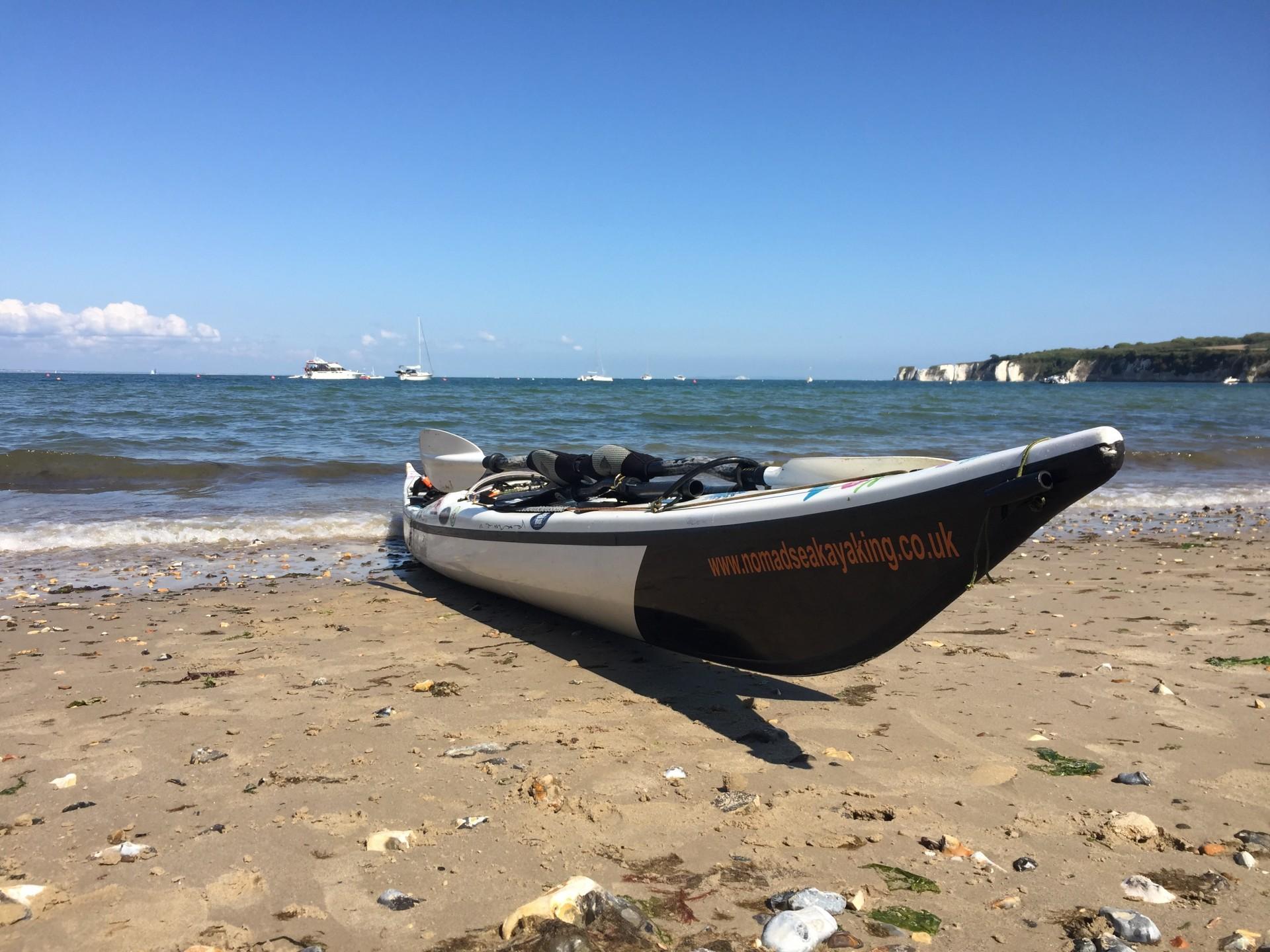 Nigel Dennis design NDK Explorer HV composite sea kayak on a beach