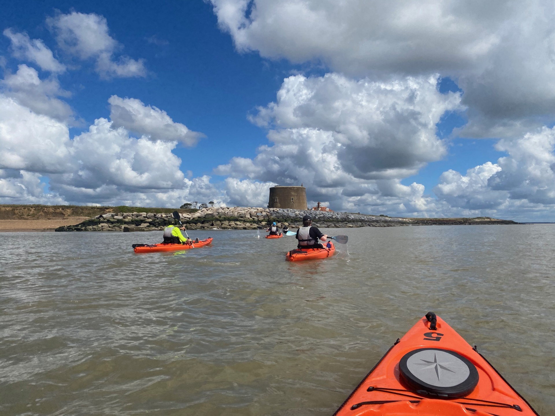 Kayakers on the water on a beginner kayaking and wild camping trip in Suffolk