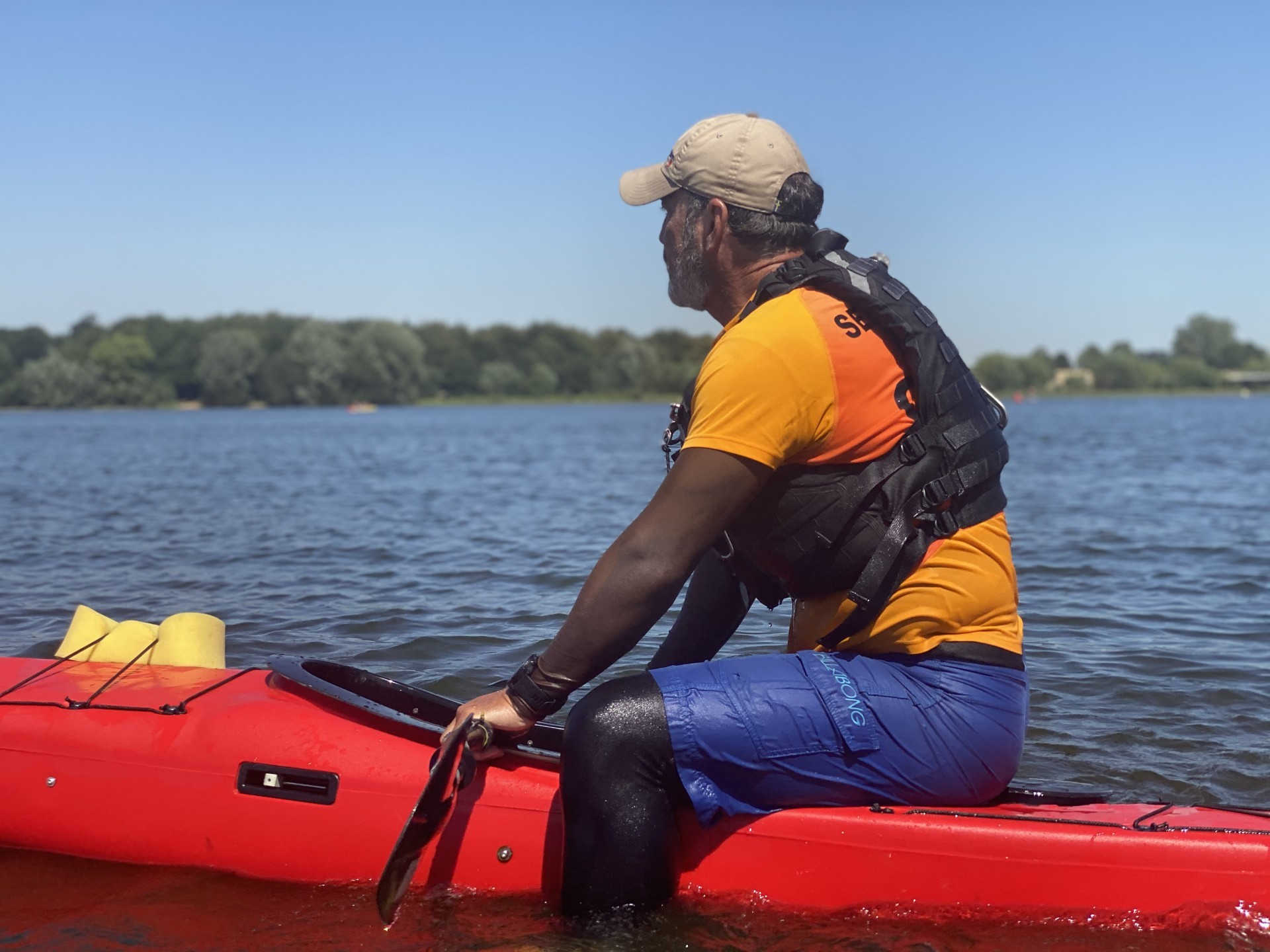 Stable NDK Sport RM sea kayak with a paddler sitting on the back deck