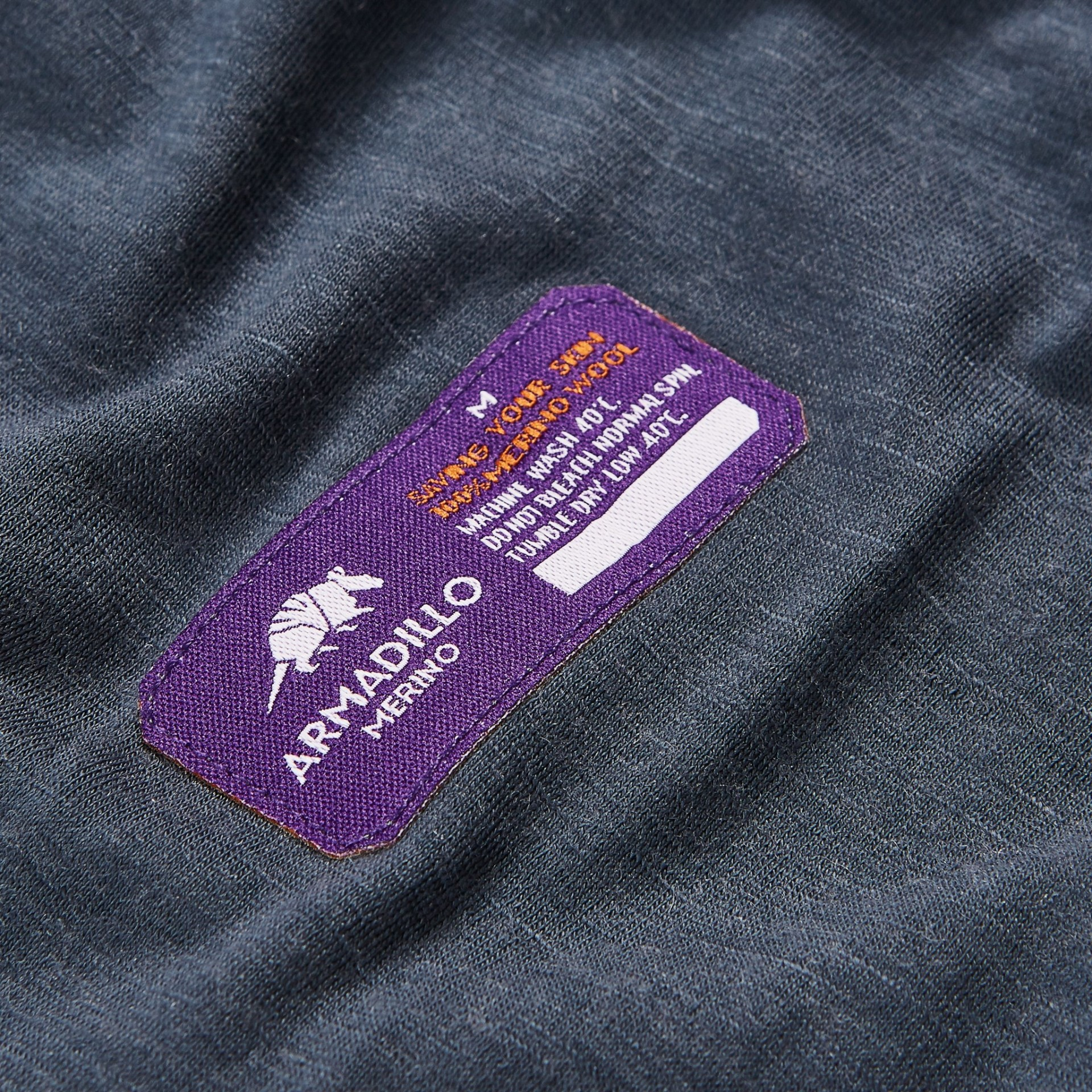Labels on the outside of merino wool base layers