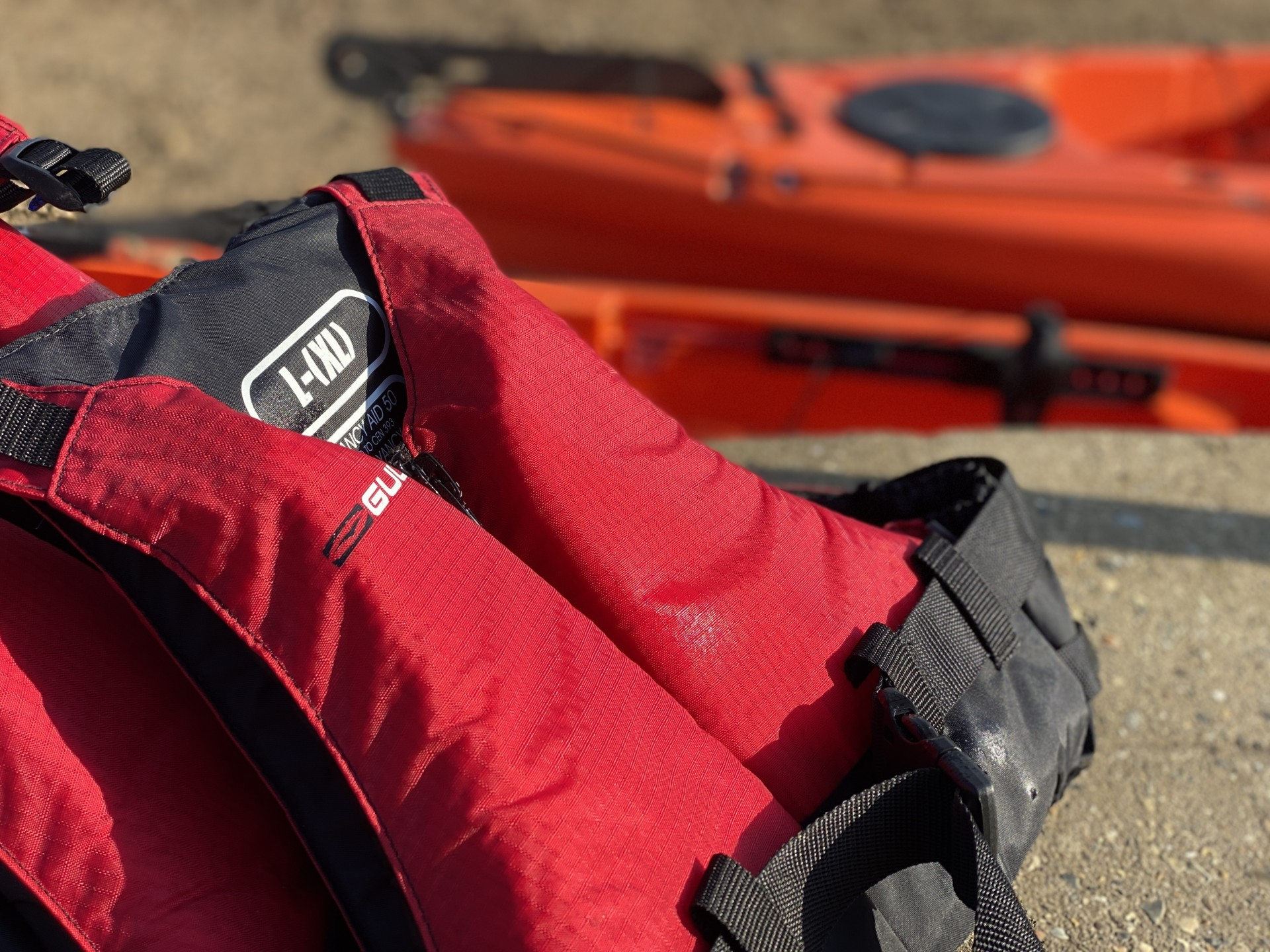 Red buoyancy aids ready for the Beach Clean by Kayak event.