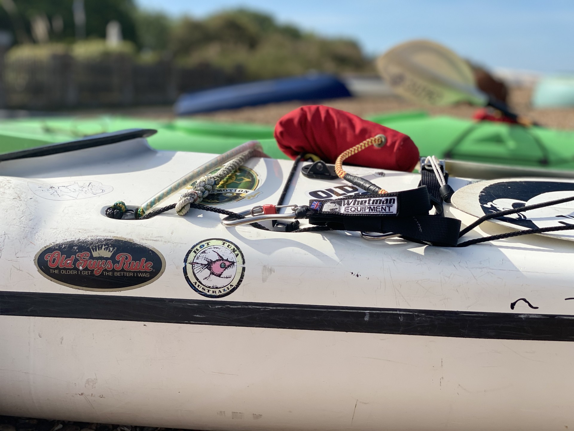 Safety equipment shown on the front deck of a sea kayak ready for a training course