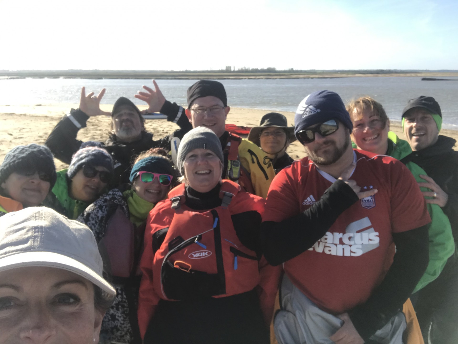 Group of smiling kayaking membership for trips and training courses.