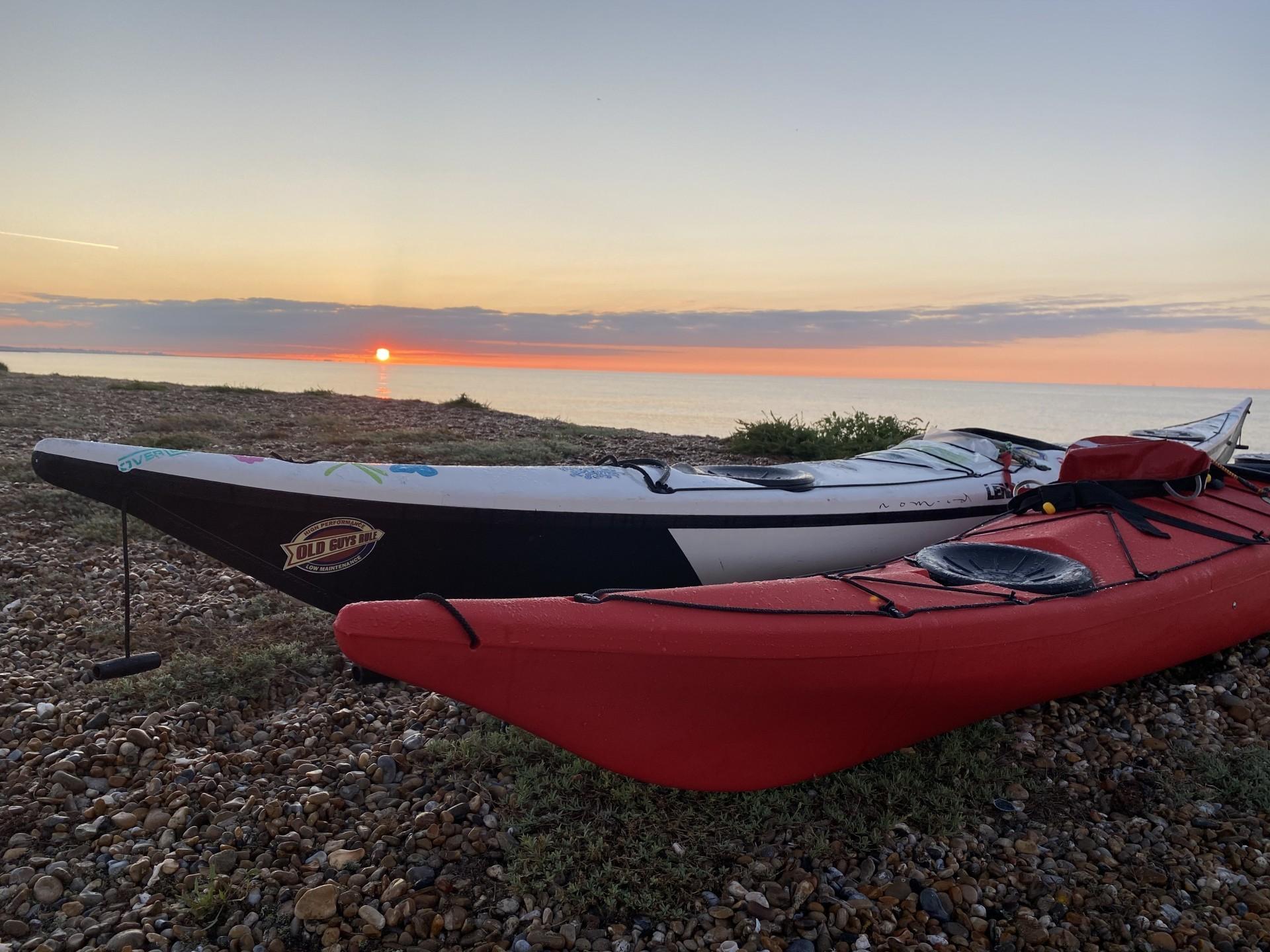 sea kayaks at sunset, Suffolk kayak and wild camping trip.