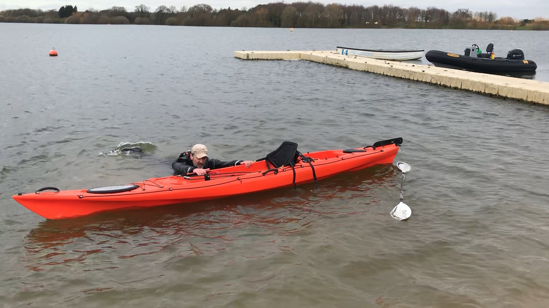/storage/Coach recovering a large sit-on-top kayak