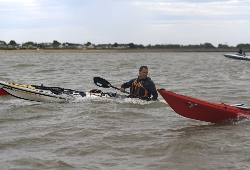Sea kayaker in choppy conditions.